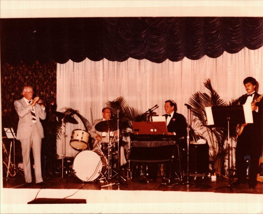 Left to Right at the Deauville Hotel, Miami Beach, 1983: Paul Novak on trumpet, Lou Novak on drums, Bob Novack on keyboards, and Paul Novack on guitar.